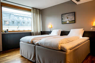 bed in standard room at scandic anglais in stockholm