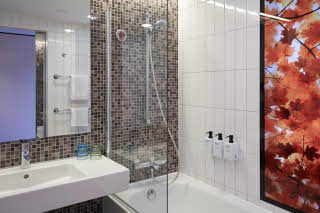 bathroom in room superior at scandic berlin potsdamer platz in germany