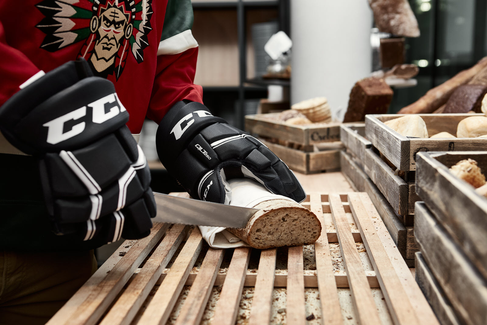 Hockey player cutting up bred into slices