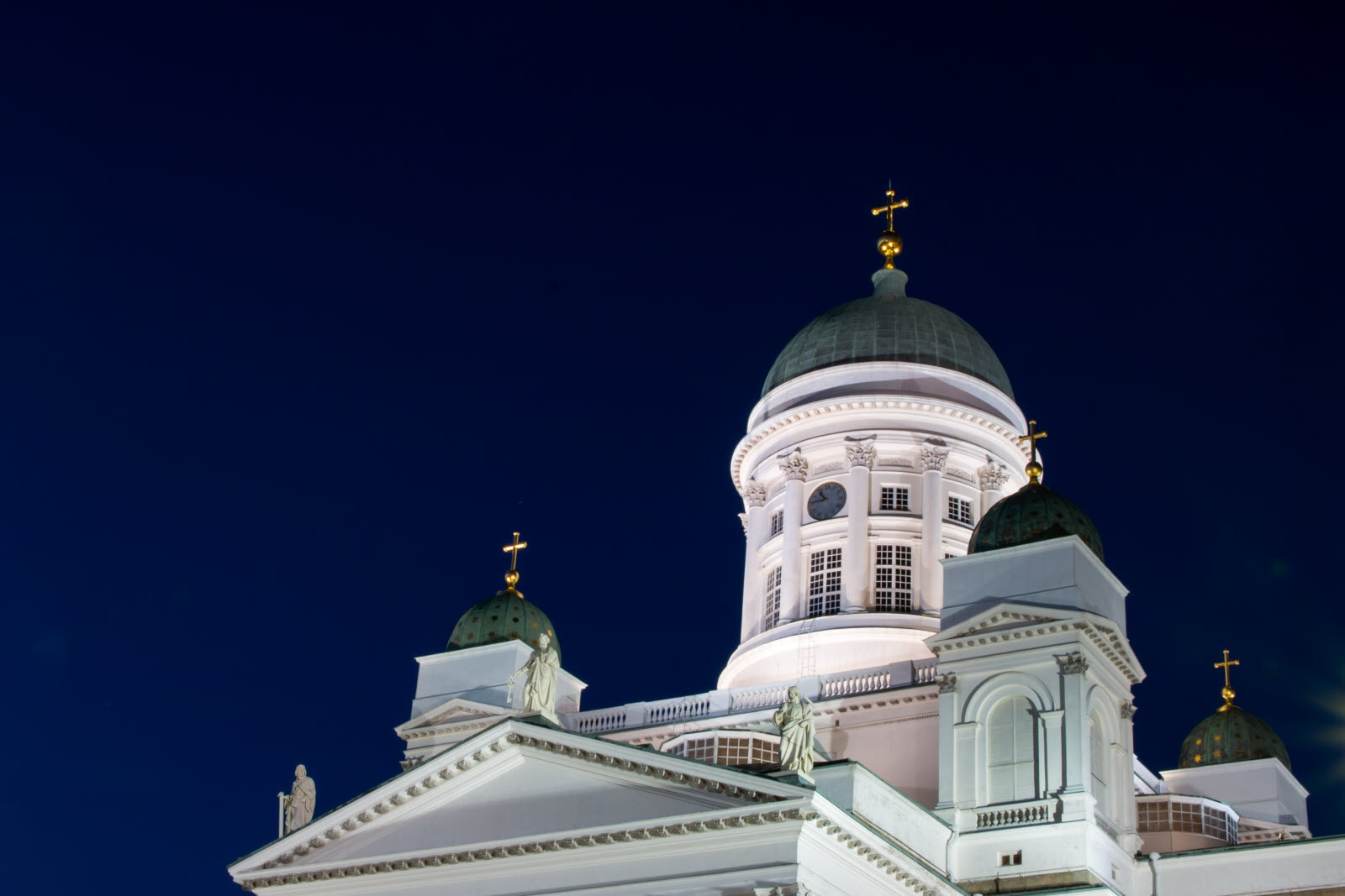 Illuminated Helsinki Cathedral at night.