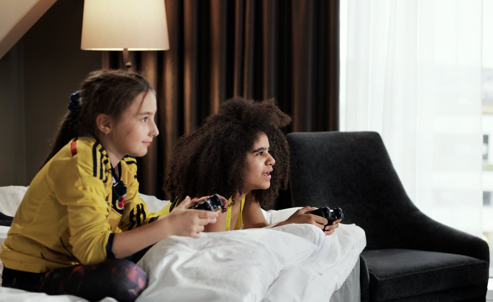 Two sports children playing TV games
